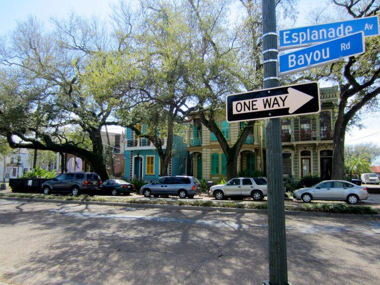 Road Trip USA: Street signs and cars on the Esplanade, New Orleans