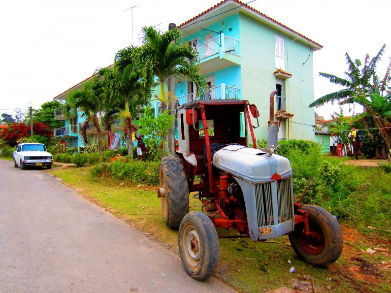 Cycling Cuba: House, tractor and car on the road