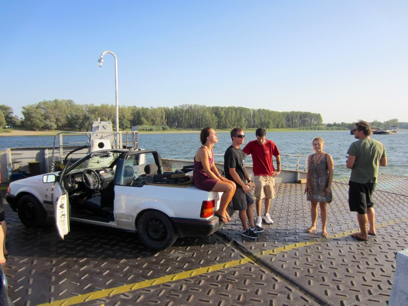 People on the car-ferry over the Danube