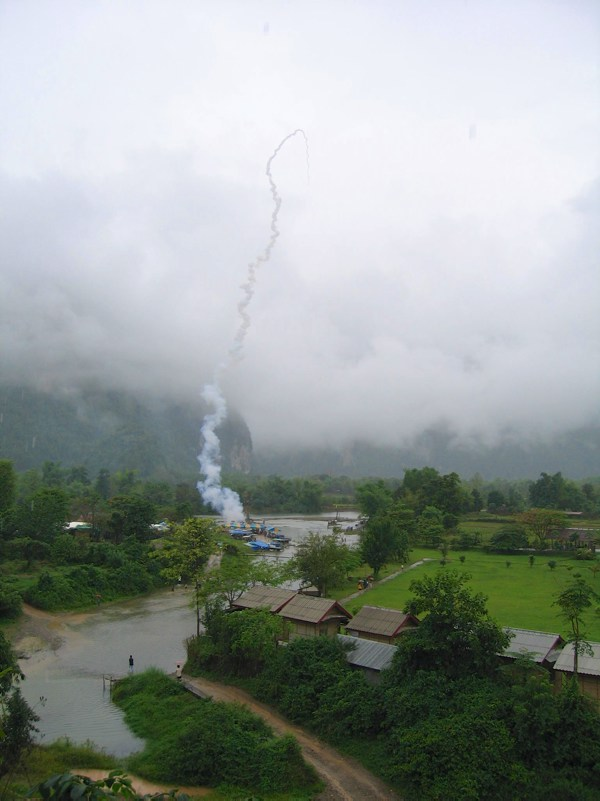 Festivals around the world: Rocket taking off over field and jungle