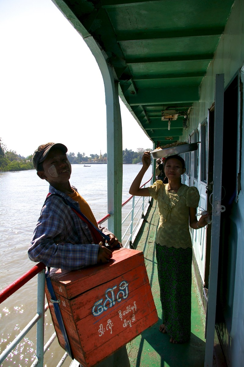Salespeople on a boat on the Ayeyarwaddy