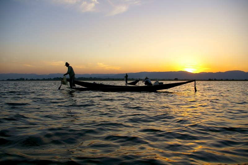 Boat in the sunset on the  Inle Lake