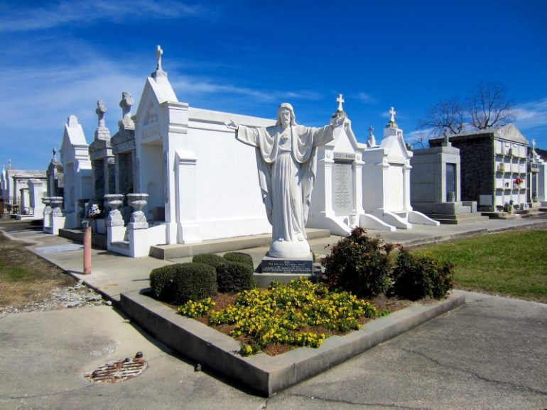 Most beautiful cemeteries: Graves and statue, New Orleans