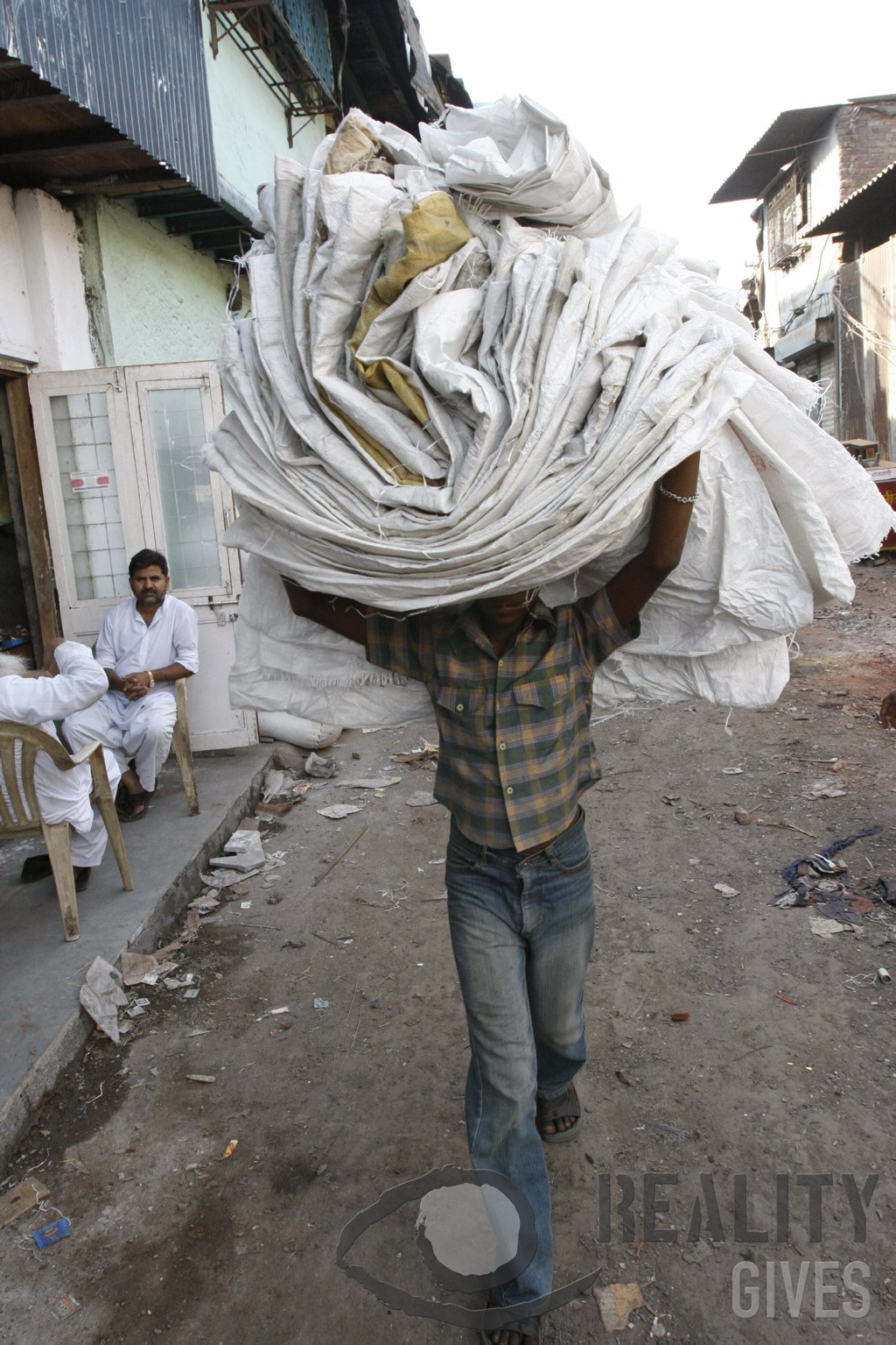 Ragpicker carrying recycled bags - Cory Goldberg