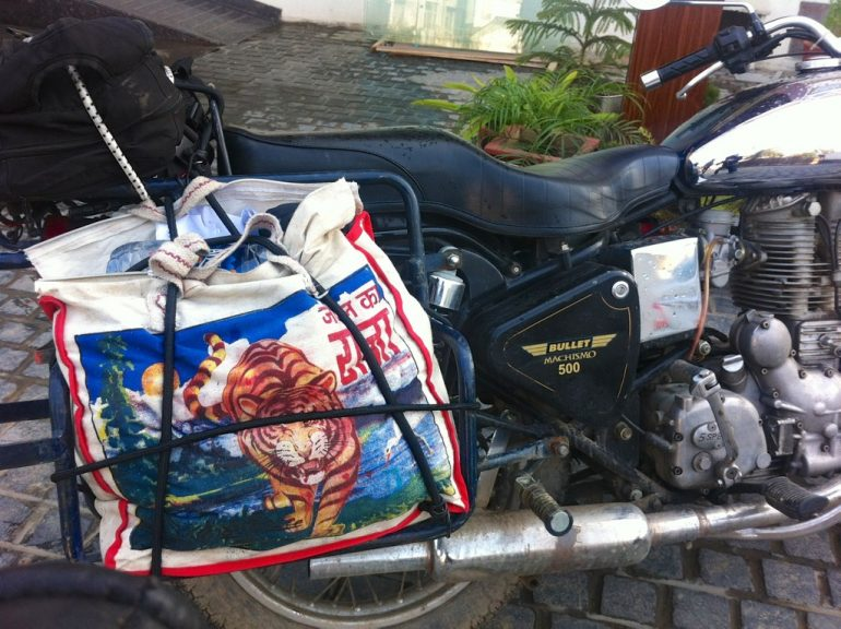Renting an Enfield in India: Indian bag strapped to a Royal Enfield