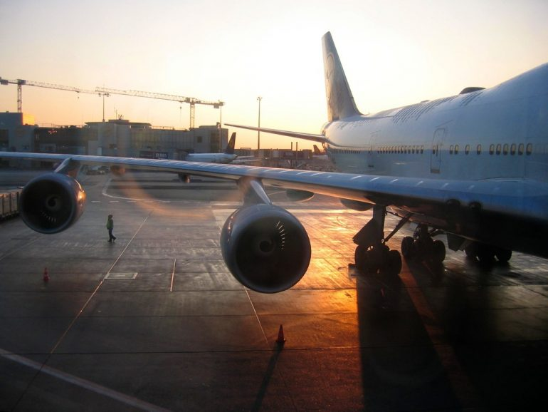 Budget Travel: A plane in the sunrise at an airport