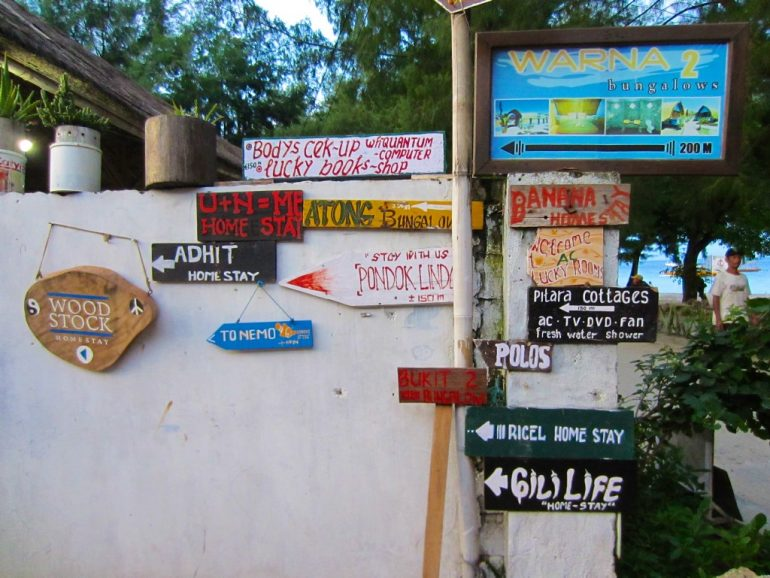 Budget travel: Hotel signs on Gili Trawangan