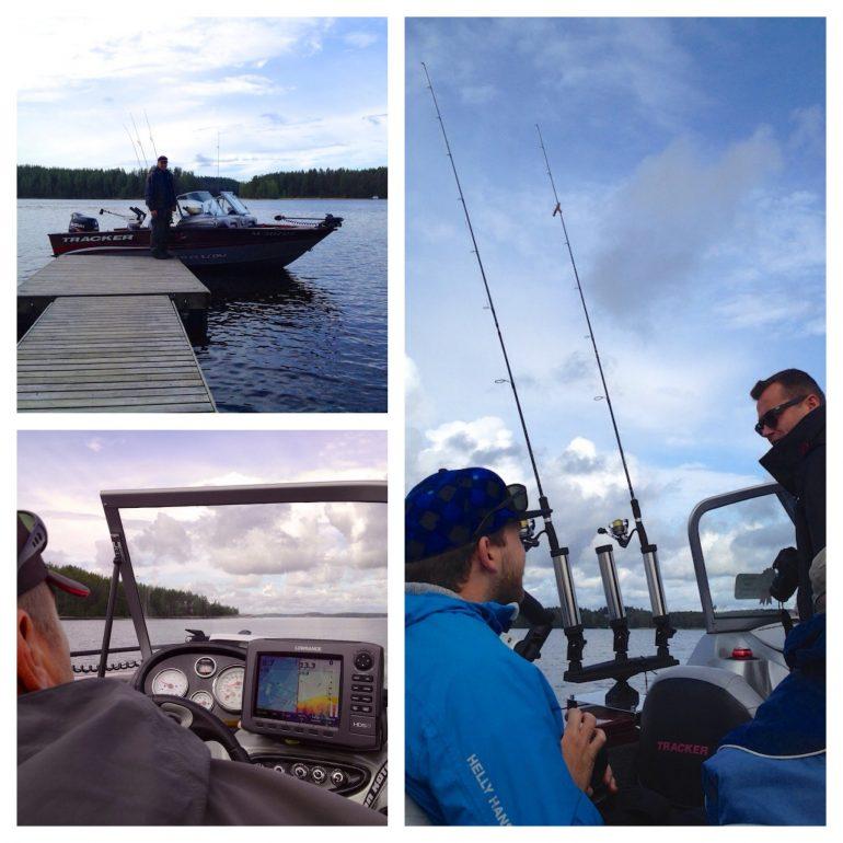 Menschen beim angeln auf einem Boot in Finnland