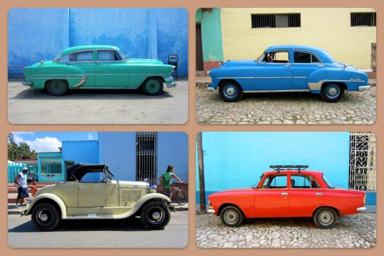 Vier alte Autos in Kuba in unterschiedlichen Farben