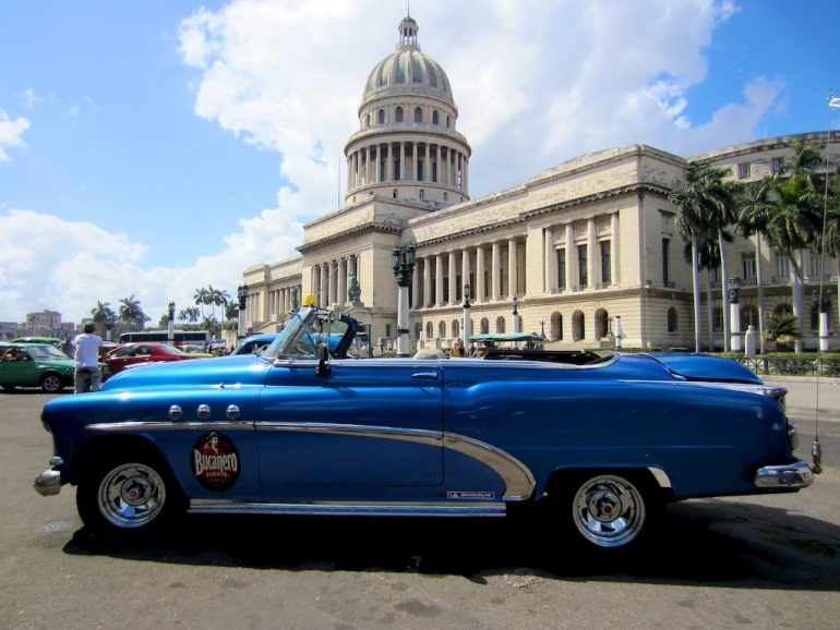 Cuba cars: American classic car in front of the Capitolio