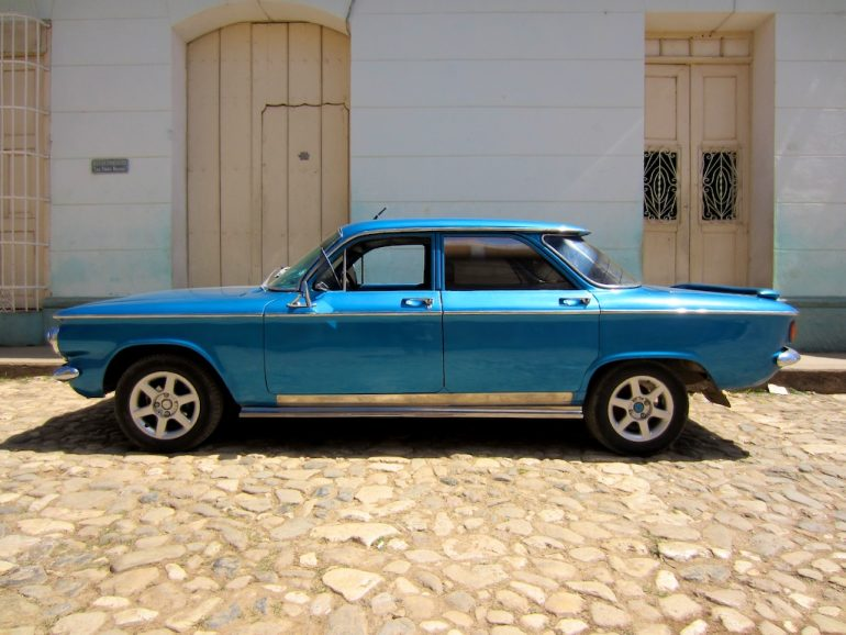 Cuba cars: Blue car in front of building