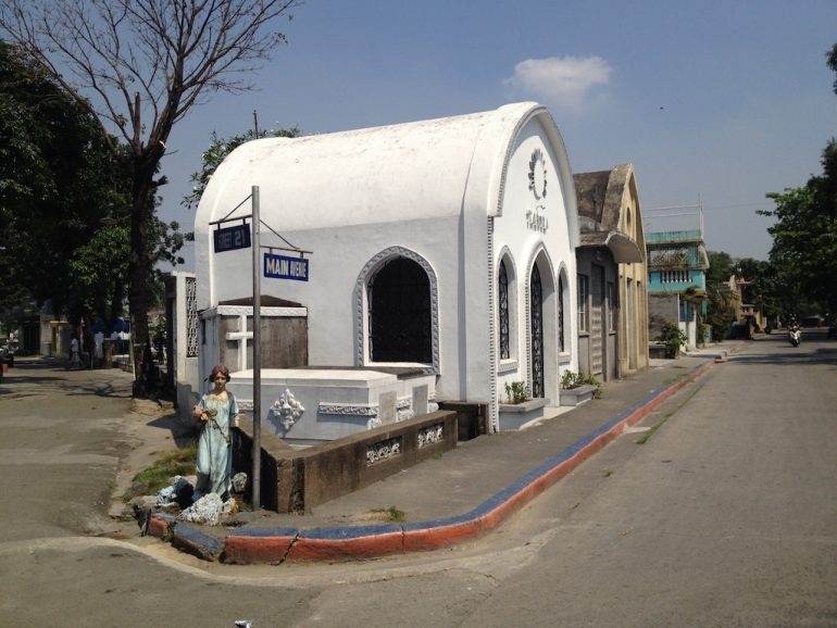 Most beautiful cemeteries: Street and graves in Manila