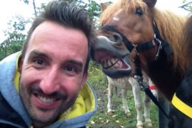 Say Cheese: Marco Buch with a smiling horse.