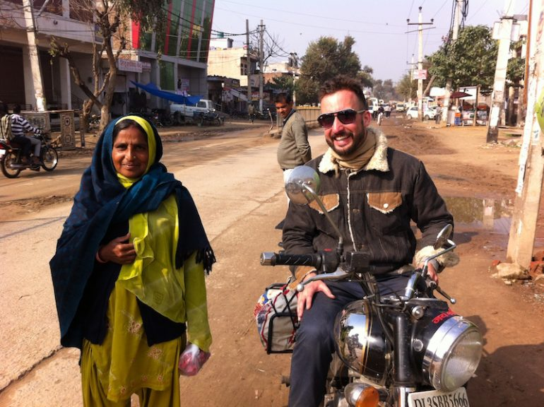Best road trips: Marco Buch with a local on the streets of Rajasthan.